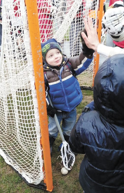 B'ville Lax team 'adopts' young boy