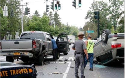 Car flips over in traffic accident on Forman Street